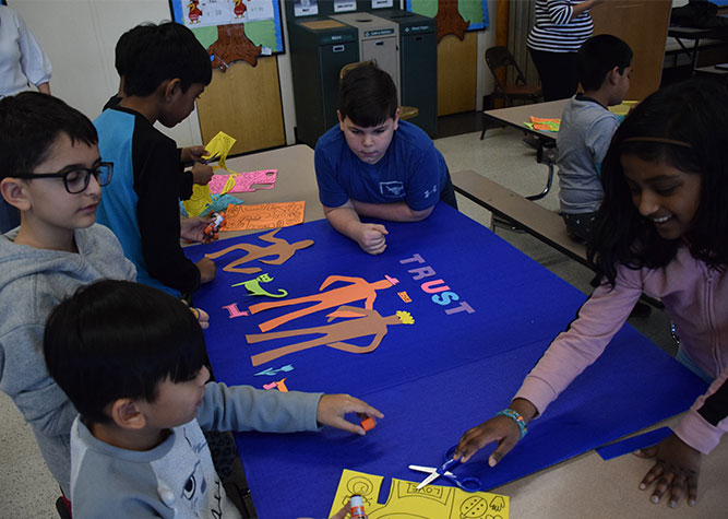 Students Prep for Mural on Unity and Kindness photo